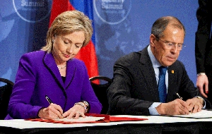 (Apr. 14) -U.S. Secretary of State Hillary Clinton and Russian Foreign Minister Sergei Lavrov sign an updated version of a 10-year-old agreement on eliminating surplus weapon-usable plutonium (Brendan Hoffman/Getty Images).