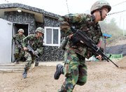 (Jun. 21) -South Korean soldiers participate in a drill last month near the Demilitarized Zone dividing the Koreas. South Korea today reported finding high levels of radiation in May near its border with the North (Getty Images).