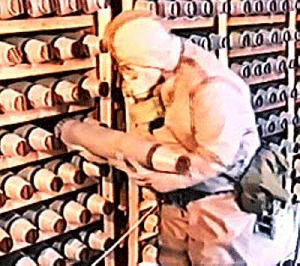 (Jun. 30) -A soldier examines a chemical munition in storage at Russia's Shchuchye chemical weapons repository. Moscow has indicated it would not finish eliminating its chemical-weapon stocks ahead of an internationally mandated 2012 deadline (Russian Army Archives/Gannett News Service).