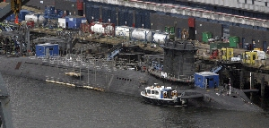 (Jul. 14) -A British Vanguard-class ballistic missile submarine, shown docked at a naval base in Scotland in 2007. The United Kingdom yesterday indicated it would consider making cuts to its strategic nuclear deterrent (Maurice McDonald/Getty Images).