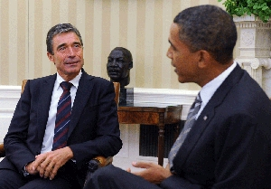 (Sep. 8) -NATO Secretary General Anders Fogh Rasmussen, left, speaking yesterday with U.S. President Barack Obama. Rasmussen told reporters the military alliance would announce at a November summit a decrease in its dependence on nuclear arms for deterrence (Roger Wollenberg/Getty Images).