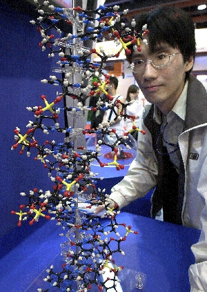 (Sep. 10) -A man looks at a model DNA strand at a 2003 medical exhibition in Taiwan. Some scientists have expressed concern that terrorists might one day use man-made genetic material as a basis for recreating or adapting dangerous disease agents (Sam Yeh/Getty Images).