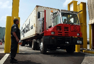 (Oct. 1) -A truck in 2007 pulls a shipping container through a radiation portal scanner at the Port of Palm Beach in Florida. The new chief of the U.S. Domestic Nuclear Detection Office yesterday indicated the agency would wrap up work within a year on a next-generation detection system designed to help prevent illicit nuclear material transfers (Joe Raedle/Getty Images).