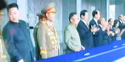 (Oct. 13) -A television in Seoul shows North Korean leader Kim Jong Il, his youngest son and presumed successor Kim Jong Un and other top officials on the sidelines of a military parade on Sunday. Three new ballistic missiles and their launchers were reportedly displayed for the first time at the event (Park Ji-hwan/Getty Images).