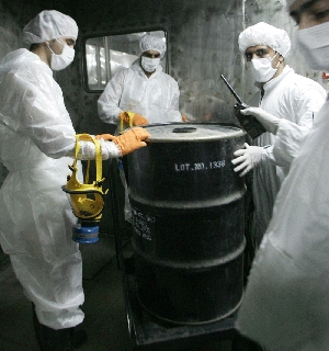 "(Oct. 28) -Technicians in 2005 transfer a container of unrefined uranium ""yellowcake"" at Iran's Isfahan uranium conversion facility. The United States and its European allies are nearing consensus on a new plan for the exchange of Iranian low-enriched uranium, according to a senior U.S. official (Behrouz Mehri/Getty Images)."