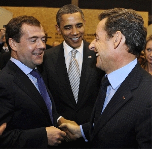 (Nov. 22) -From left to right, Russian President Dmitry Medvedev, U.S. President Obama and French President Nicolas Sarkozy chat Saturday during the NATO summit in Lisbon, Portugal. The military alliance agreed to move ahead with development of an integrated missile shield (Dominique Faget/Getty Images).