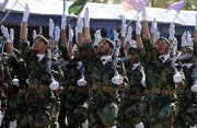 (Dec. 17) -Members of Iran's Revolutionary Guard march in a September armed forces parade in Tehran. The United States and Arab nations could respond to Iran's disputed nuclear work in part with sanctions focused on the elite military group (Atta Kenare/Getty Images).