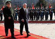 (Jan. 10) -U.S. Defense Secretary Robert Gates, right, takes part in an arrival ceremony today in Beijing with Chinese Defense Minister Liang Guanglie. Gates expressed concern Saturday about China's recent  progress in developing new weapons systems (Larry Downing/Getty Images).