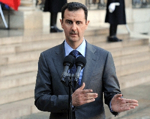 (Jan. 31) -Syrian President Bashar Assad, shown last month, said Damascus would not sign onto a protocol that would give U.N. monitors greater latitude in examining Syrian nuclear facilities for possible evidence of weapons work (Miguel Medina/Getty Images).