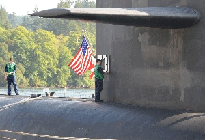 (Feb. 4) -U.S. Navy personnel perform maintenance on the Ohio-class ballistic-missile submarineUSS Alabamain 2009. The Navy last year called for a next-generation submarine to include four fewer missile tubes than the number recommended by U.S. Strategic Command, military insiders said (U.S. Navy photo).