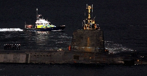 (Feb. 23) -A British ballistic-missile submarine leaves Faslane Naval Base in 2009. The United Kingdom could not reduce the fleet of four nuclear-armed vessels without undermining its deterrent,  Defense Secretary Liam Fox said (Jeff Mitchell/Getty Images).