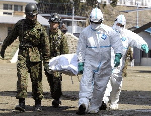 (Mar. 16) -A suspected radiation exposure victim is transported on Monday at a treatment center in Japan's Fukushima prefecture. Japan on Wednesday said another reactor containment vessel might have broken open at a severely damaged Japanese nuclear plant (Getty Images).