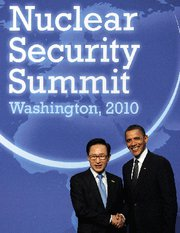 (Mar. 18) -U.S. President Obama, right, greets South Korean President Lee Myung-bak at the 2010 Nuclear Security Summit in Washington. Participants in the next summit, planned for 2012 in Seoul, might address efforts to secure potential radiological-weapon materials, according to officials (Jewel Samad/Getty Images).