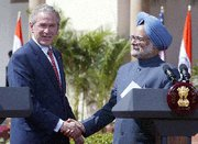 (Apr. 15) -Then-U.S. President Bush, left, and Indian Prime Minister Manmohan Singh shake hands on March 2, 2006, the day they signed a bilateral civil nuclear trade agreement. A U.S. House of Representatives panel on Thursday overwhelmingly endorsed a bill to strengthen congressional oversight of future similar deals (Raveendran/Getty Images).