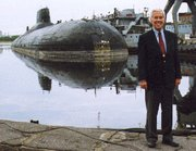 (Jul. 12) -U.S. Senator Richard Lugar (R-Ind.) poses near a Russian Typhoon-class ballistic-missile submarine in 1999. The Nunn-Lugar Cooperative Threat Reduction program eliminated a nuclear-capable submarine earlier this year, the senator said on Monday (U.S. Senator Richard Lugar photo).
