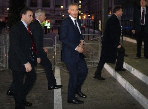 (Aug. 1) -Former British Prime Minister Tony Blair, center, arrives in January to testify before an independent panel investigating his country's participation in the Iraq War. The inquiry is expected in a forthcoming report to sharply criticize Blair's moves to involve the United Kingdom in the conflict (Peter Macdiarmid/Getty Images).