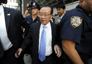 (Aug. 1) -North Korean Vice Foreign Minister Kim Kye Gwan, center, leaves his hotel on Thursday for talks with U.S. special envoy Stephen Bosworth in New York City (Timothy Clary/Getty Images).