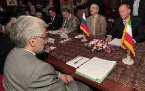 (Aug. 15) -Senior Iranian nuclear negotiator Saeed Jalili, left, sits across from Russian Presidential Security Council chief Nikolai Patrushev at a meeting in Tehran on Monday. Patrushev is expected during his visit to discuss a Russian proposal aimed at resolving international concerns over Iran's nuclear program (Behrouz Mehri/Getty Images).