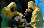 (Aug. 19) -U.S. military personnel decontaminate a mock victim during a June anti-WMD drill in Wisconsin. Extremists have become more likely to acquire WMD-related materials through independent organizations tied to states, the U.S. State Department said on Thursday (U.S. Army photo).