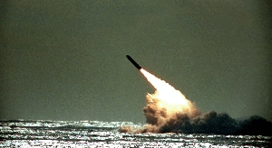 (Oct. 18) -A U.S. Navy Trident D-5 ballistic missile takes off in a December 1989 flight test.  A high-ranking U.S. military commander on Tuesday said the nation might someday eliminate one leg of the nuclear triad, which today constitutes long-range bomber aircraft, ICBMs and submarine-based missiles (AP Photo/Phil Sandlin).