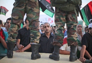 (Nov. 2) -Demonstrators rally in support of Libya's Transitional National Council last month in Tripoli. The interim government on Tuesday indicated it had seized two chemical weapons storage facilities never reported by the ousted Qadhafi regime (AP Photo/Alexandre Meneghini).
