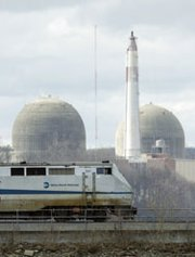 A train passes by the Indian Point Nuclear Power Plant, just north of New York City, in March 2011. The Nuclear Regulatory Commission is pushing back by three weeks a key rulemaking that could determine the fate of this and other similar plants (photo by DON EMMERT/AFP/Getty Images).