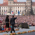 President Barack Obama and First Lady Michelle Obama address a cheering crowd, April 5, 2009, Prague's Hradcany Square.