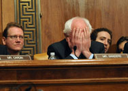 U.S. Bernard Sanders (I-VT) covers his face during a 2009 hearing. Sanders is considering introducing a bill that would end liability limits for the nuclear power industry in the event of a disaster.