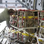 A National Nuclear Security Administration technician from the Y-12 National Security Complex in Oak Ridge, Tenn., inspects casks of highly enriched uranium aboard a U.S. Air Force C-17 in February 2012. The Government Accountability Office says NNSA officials do not have a clear vision for how to improve security after a 2012 break-in at the Y-12 facility.