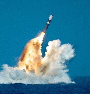 A U.S. Ohio-class submarine launches a Trident D-5 missile. The Obama administration might reconsider a plan to replace one Trident D-5 nuclear warhead, the W-88, with an interoperable warhead that could also be used on ground-based missiles, congressional aides and other observers say (Getty Images).