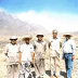 Dr. AQ Khan (hatless) with Pakistani nuclear scientists after the Chagai Hills test in 1998 with dust from the detonation.