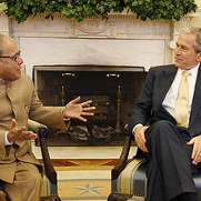 President George W. Bush and India's Minister of External Affairs Pranab Kumar Mukherjee in the Oval Office March 24, 2008.