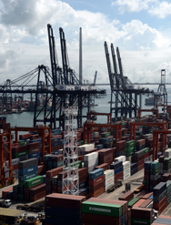 Containers and cranes are seen at a port in Hong Kong in August. U.S. lawmakers and Homeland Security Department officials are studying whether the department's container-security initiative can establish a presence at the ports it considers most vulnerable to the illicit smuggling of weapons of mass destruction (Photo by LAURENT FIEVET/AFP/Getty Images).
